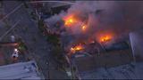 Los Angeles fire crews battle massive commercial building fire